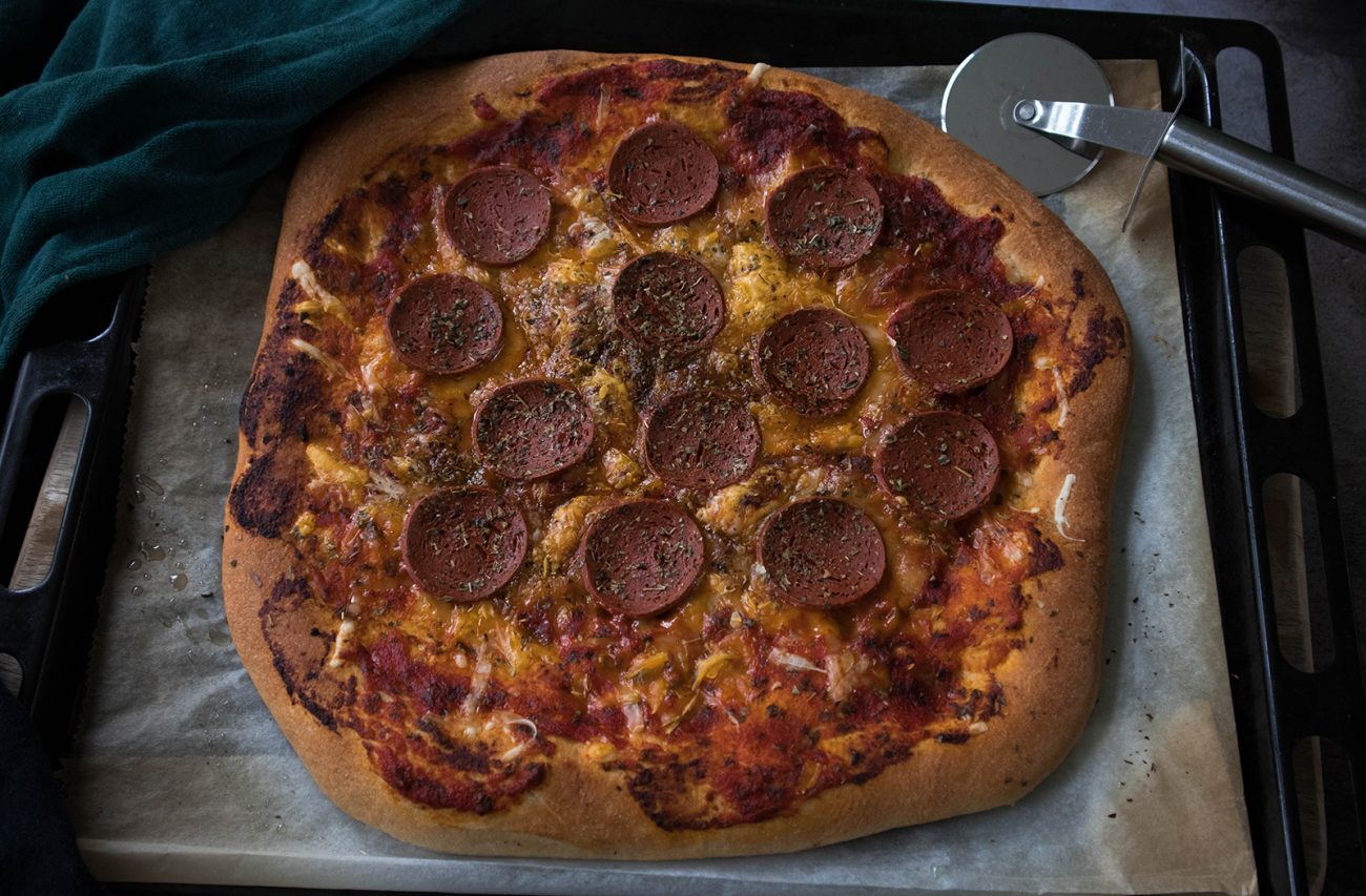 Vegan pepperoni pizza